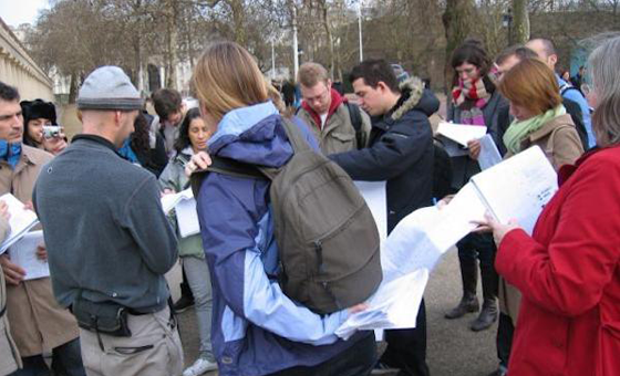 Group of people looking at maps