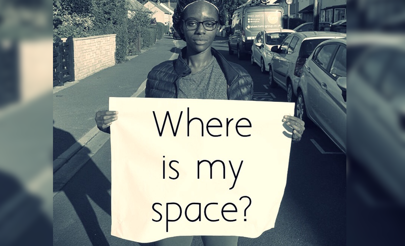 woman holding protest sign on street